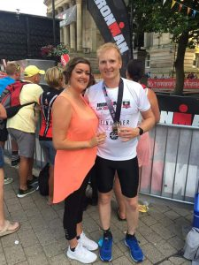 Paul Booth proudly showing off his Iron Man medal with girlfriend Nicola Doyle